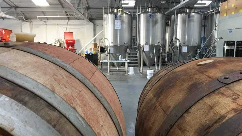 Brewery Tour of Black Husky Brewing in Milwaukee - oak barrels and stainless steel fermentation tanks