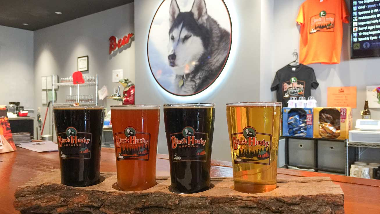 Inside Black Husky Brewing - Featured image with beer flight