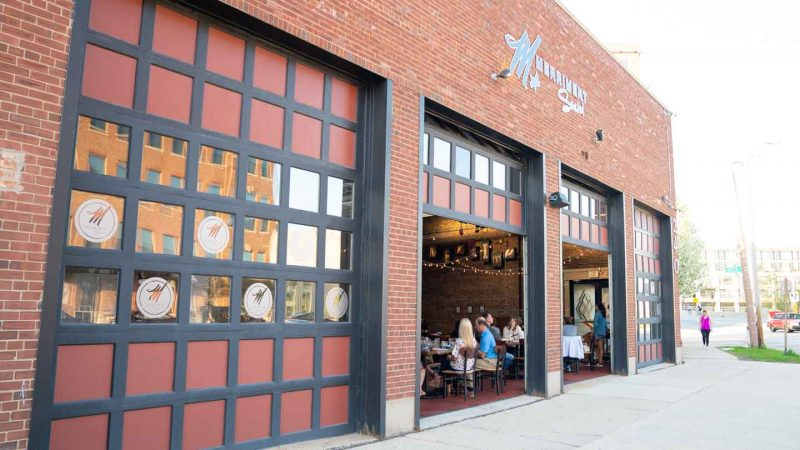 roll up doors of Merriment Social in Milwaukee - Top burger joints